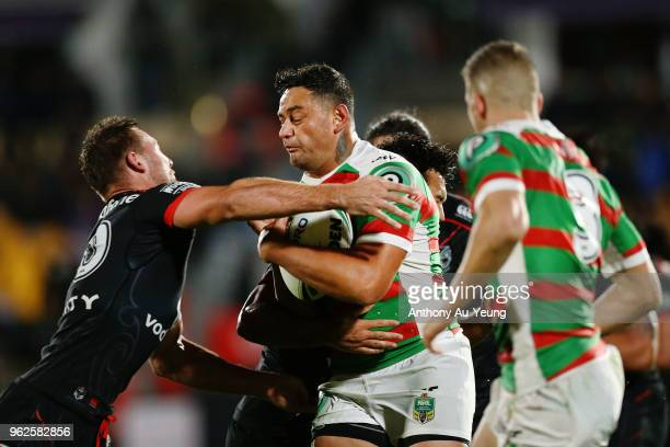John Sutton of the Rabbitohs on the charge against Karl Lawton of the Warriors during the round 12 NRL match between the New Zealand Warriors and the...