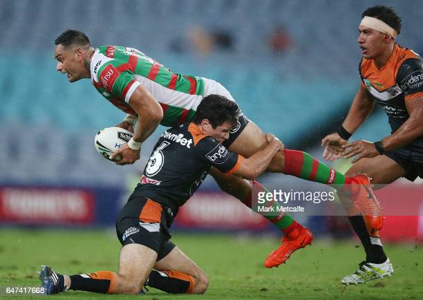 John Sutton of the Rabbitohs passes as he is tackled by Mitch Moses during the round one NRL match between the South Sydney Rabbitohs and the Wests...