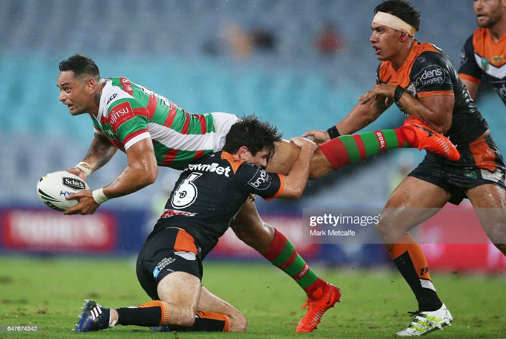 John Sutton of the Rabbitohs passes during the round one NRL match between the South Sydney Rabbitohs and the Wests Tigers at ANZ Stadium on March 3, 2017 in Sydney, Australia.