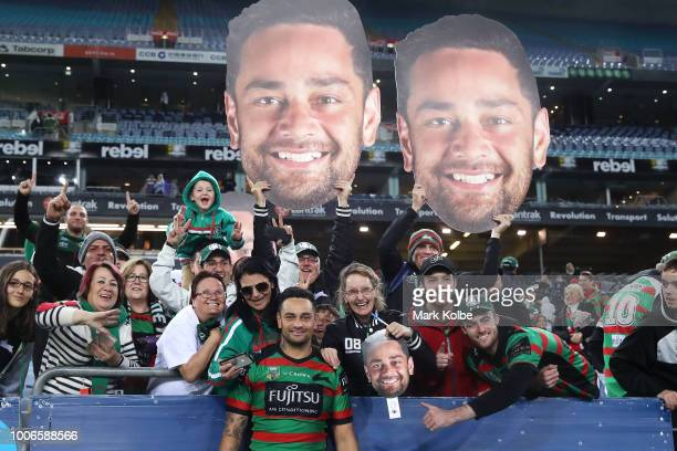 John Sutton of the Rabbitohs poses with the crowd as he leaves the field after playing his 300th match during the round 20 NRL match between the...