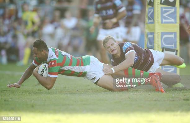 John Sutton of the Rabbitohs scores a try during the round two NRL match between the Manly Sea Eagles and the South Sydney Rabbitohs at Lottoland on...