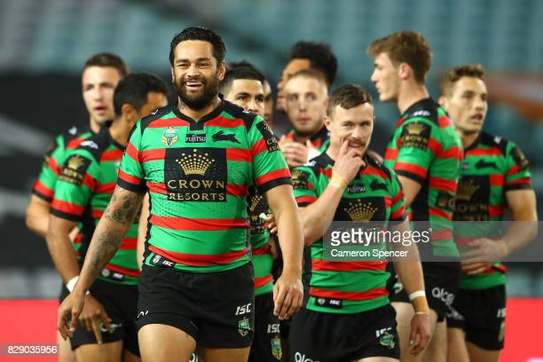 John Sutton of the Rabbitohs smiles after a try by team mate Bryson Goodwin during the round 23 NRL match between the South Sydney Rabbitohs and the...
