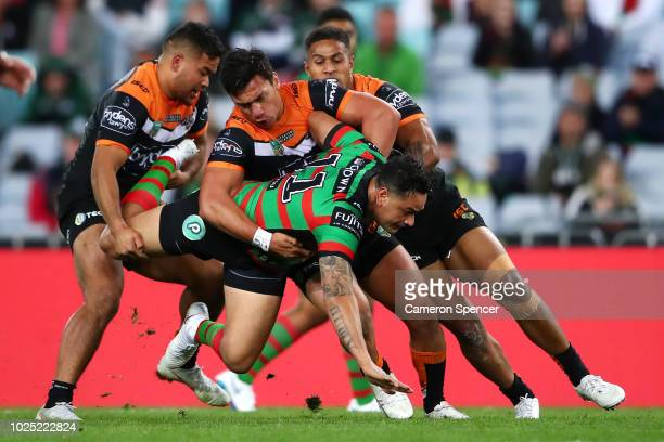 John Sutton of the Rabbitohs tackled during the round 25 NRL match between the South Sydney Rabbitohs and the Wests Tigers at ANZ Stadium on August...