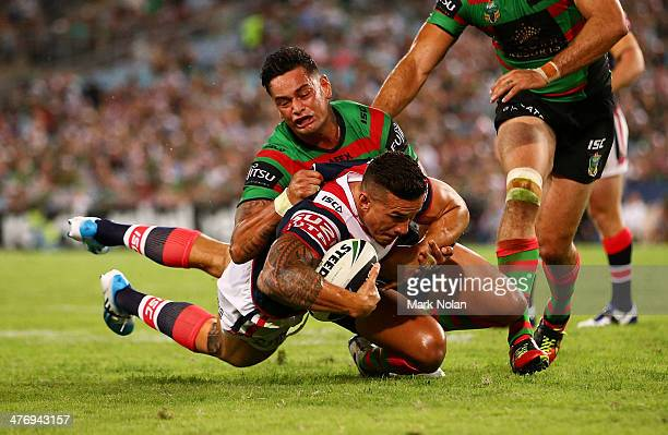 John Sutton of the Rabbitohs tackles Sonny Bill Williams of the Roosters during the round one NRL match between the South Sydney Rabbitohs and the...