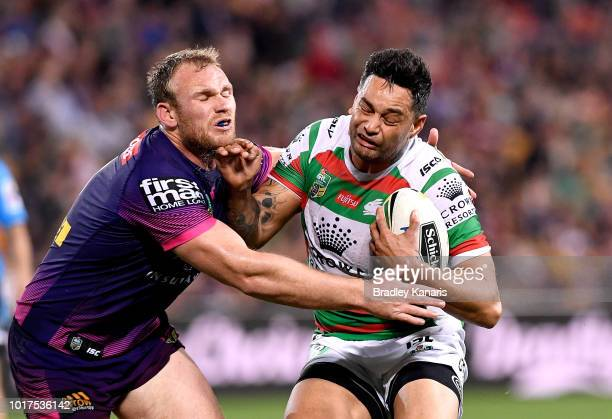 John Sutton of the Rabbitohs takes on the defence of Matt Lodge of the Broncos during the round 23 NRL match between the Brisbane Broncos and the...