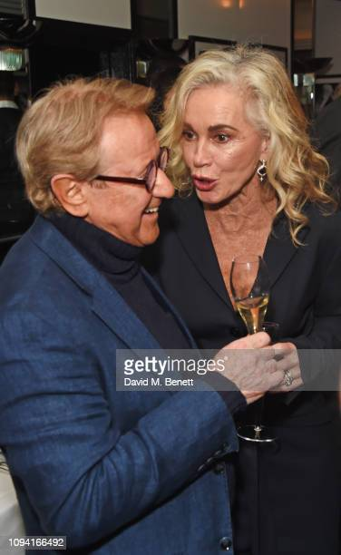 John Swannell and Angie Rutherford attend the launch of John Swannell's photography exhibition at Le Caprice on February 5 2019 in London England