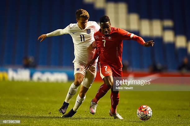 John Swift of England challenges Lopez Garcia of Switzerland during a European Under 21 Qualifier between England U21 and Switzerland U21 at Amex...