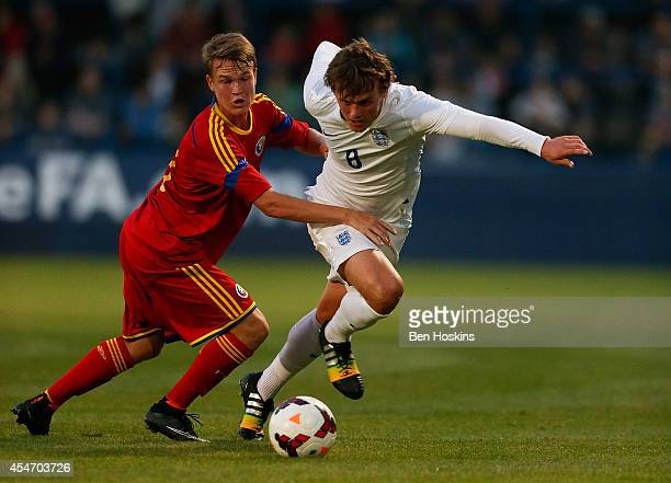 John Swift of England holds off pressure from Andy Asandului of Romania during the U20 International friendly match between England and Romania on...