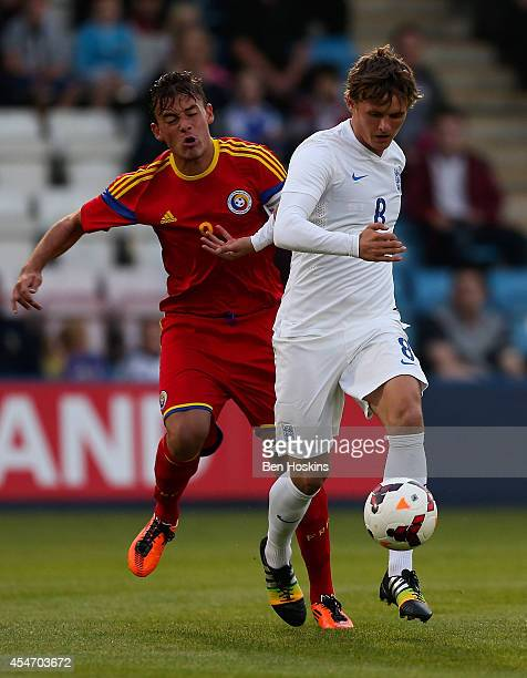 John Swift of England holds off pressure from Bogdan Danciu of Romania during the U20 International friendly match between England and Romania on...