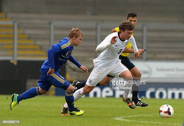 John Swift of England U19 persued by Viacheslav Tankovskyi of Ukraine U19 during the Uefa U19 Championship Elite Round match between England U19 and...