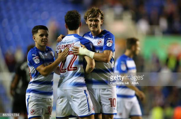 John Swift of Reading celebrates the win with Liam Kelly and Pelle Clement of Reading after the Sky Bet Championship match between Reading and Aston...