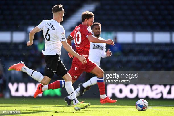 John Swift of Reading FC breaks away from of Mike te Wierik of Derby County with the ball during the Sky Bet Championship match between Derby County...