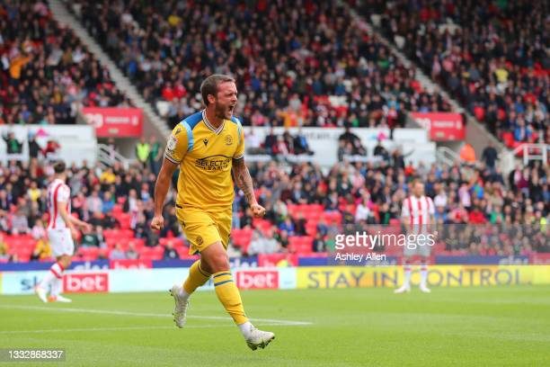 John Swift of Reading FC celebrates scoring a goal during the Sky Bet Championship match between Stoke City and Reading at Bet365 Stadium on August...