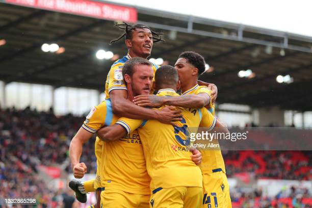 John Swift of Reading FC celebrates with teammates after scoring a goal during the Sky Bet Championship match between Stoke City and Reading at...