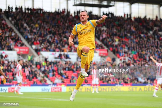 John Swift of Reading FC scores during the Sky Bet Championship match between Stoke City and Reading at Bet365 Stadium on August 07, 2021 in Stoke on...