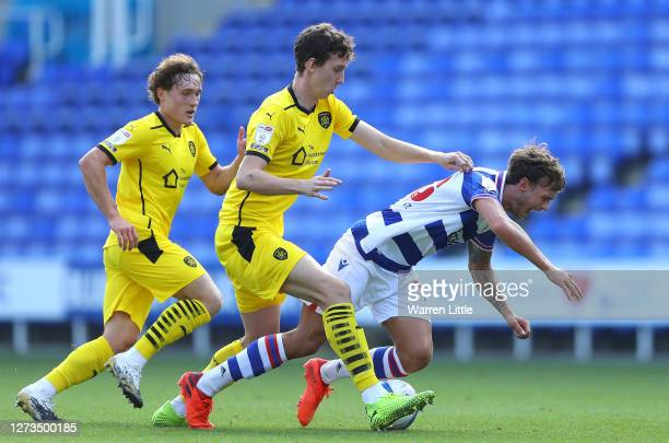 John Swift of Reading is tackled by Aapo Halme of Barnsley during the Sky Bet Championship match between Reading and Barnsley at Madejski Stadium on...