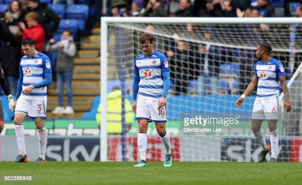 John Swift of Reading looks dejected with his team mates after they go 01 down during the Sky Bet Championship match between Reading and Ipswich Town...