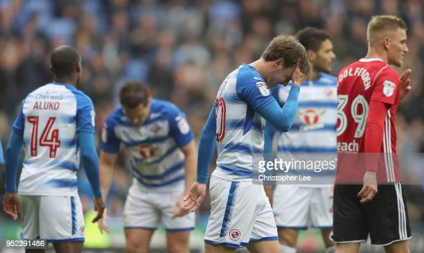 John Swift of Reading looks dejected with his team mates after they miss a chance to score during the Sky Bet Championship match between Reading and...
