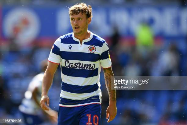 John Swift of Reading looks on during the Sky Bet Championship match between Reading and Cardiff City at Madejski Stadium on August 18, 2019 in...