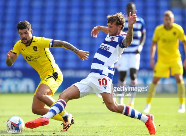 John Swift of Reading passes the ball during the Sky Bet Championship match between Reading and Barnsley at Madejski Stadium on September 19 2020 in...