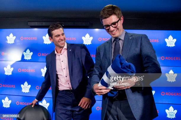 John Tavares and general manager Kyle Dubas smile during the press conference. The Toronto Maple Leafs have signed John Tavares for seven years, $77...
