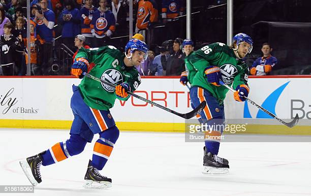 John Tavares and Nikolay Kulemin of the New York Islanders skate in warmups prior to the game against the Florida Panthers at the Barclays Center on...