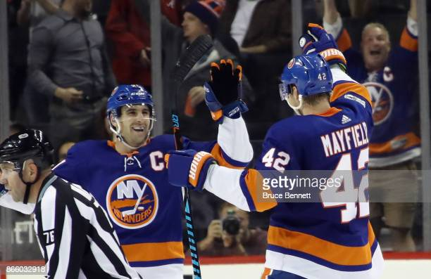 John Tavares and Scott Mayfield of the New York Islanders celebrate Mayfield's third period goal against the Arizona Coyotes at the Barclays Center...