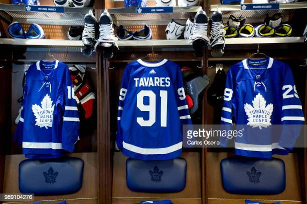TORONTO ON JULY John Tavares jersey hangs in the leafs locker room The Toronto Maple Leafs have signed John Tavares for seven years $77 million July...