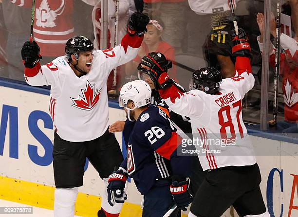 John Tavares of Team Canada celebrates his secondperiod goal by Patrice Bergeron with Sidney Crosby while playing Team USA during the World Cup of...