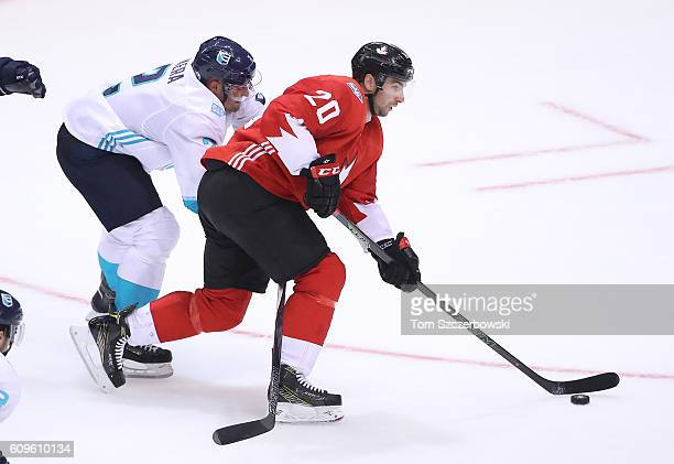 John Tavares of Team Canada skates away from Andrej Sekera of Team Europe as he attacks with the puck during the World Cup of Hockey tournament at...