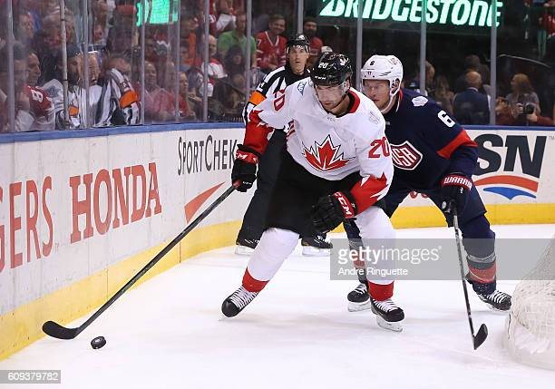 John Tavares of Team Canada stickhandles the puck with pressure from Erik Johnson of Team USA during the World Cup of Hockey 2016 at Air Canada...