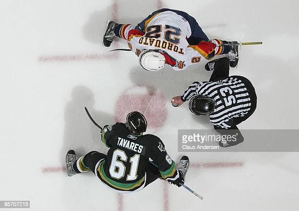 John Tavares of the London Knights gets set to take a faceoff against Zack Torquato of the Erie Otters in Game 5 of the opening round of the 2009...