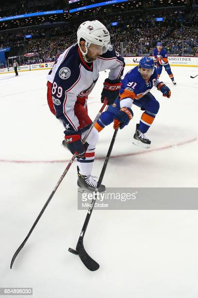 John Tavares of the New York Islanders and Sam Gagner of the Columbus Blue Jackets battle for the puck at the Barclays Center on March 18, 2017 in...