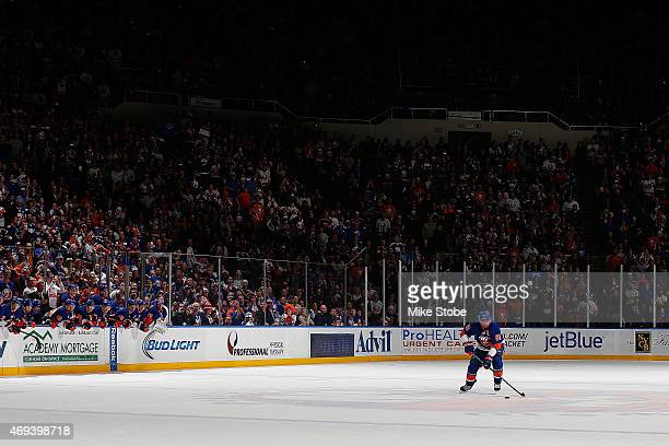 John Tavares of the New York Islanders carries the puck during the shootout against the Columbus Blue Jackets at Nassau Veterans Memorial Coliseum on...