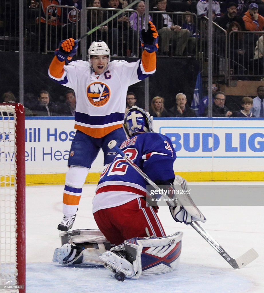 John Tavares #91 of the New York Islanders celebrates a first period goal by Johnny Boychuk #55 against Antti Raanta #32 of the New York Rangers at Madison Square Garden on March 6, 2016 in New York City.