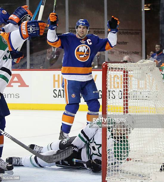 John Tavares of the New York Islanders celebrates a power play goal by Kyle Okposo at 813 of the second period against the Dallas Stars as Alex...