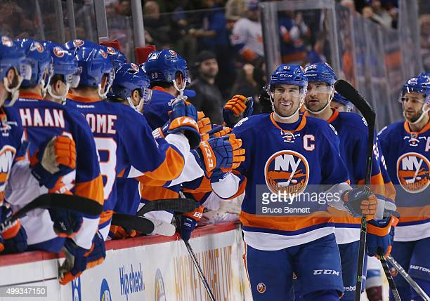 John Tavares of the New York Islanders celebrates a powerplay goal by Kyle Okposo at 1958 of the first period against the Colorado Avalanche at the...