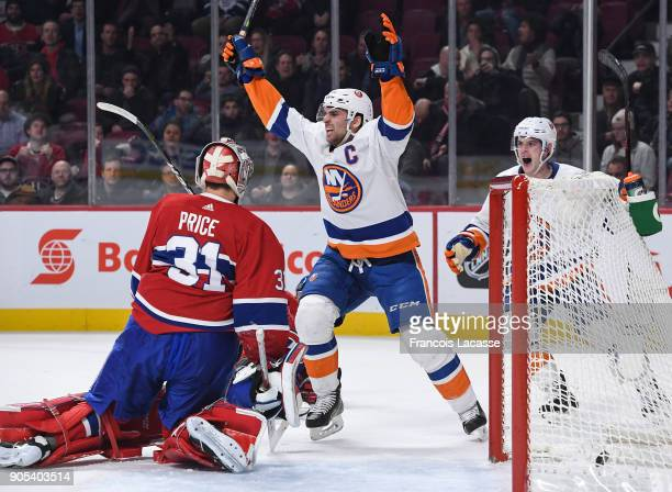 John Tavares of the New York Islanders celebrates after scoring the winning goal against the Montreal Canadiens in the NHL game at the Bell Centre on...