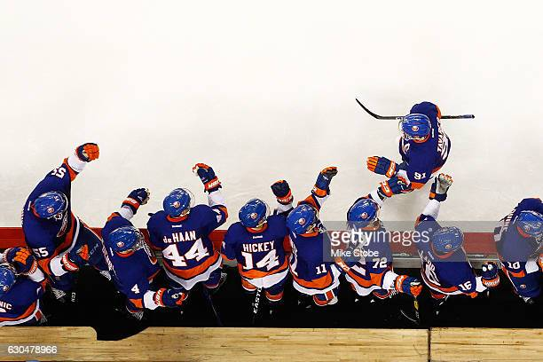 John Tavares of the New York Islanders celebrates Anders Lee goal with the bench against the Buffalo Sabres at the Barclays Center on December 23...