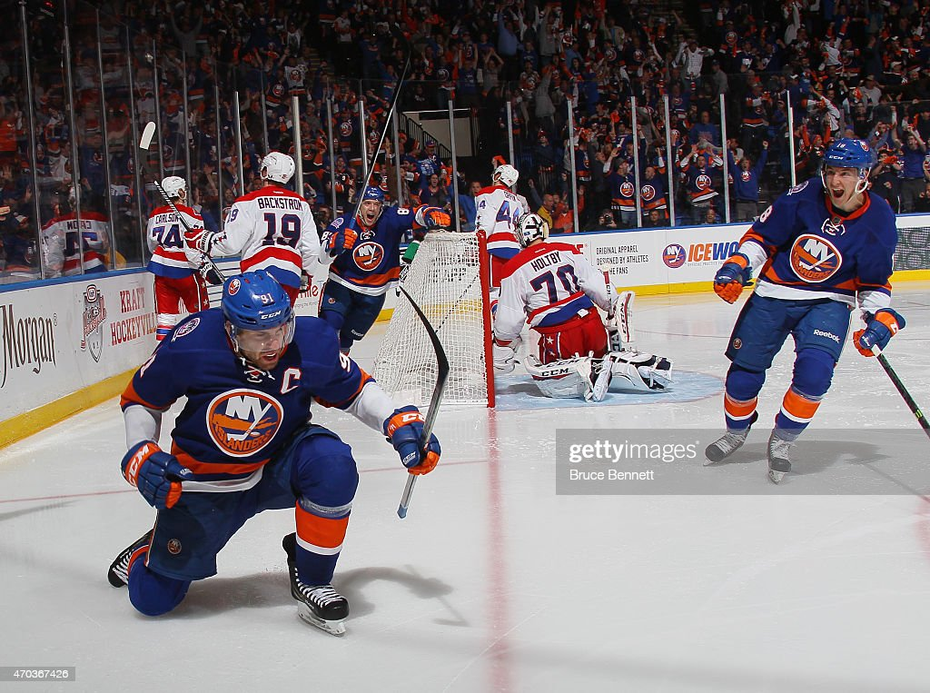 John Tavares #91 of the New York Islanders celebrates his game winning goal at 15 seconds of the overtime against the Washington Capitals in Game Three of the Eastern Conference Quarterfinals during the 2015 NHL Stanley Cup Playoffs at the Nassau Veterans Memorial Coliseum on April 19, 2015 in Uniondale, New York. The Islanders defeated the Capitals 2-1 in overtime.