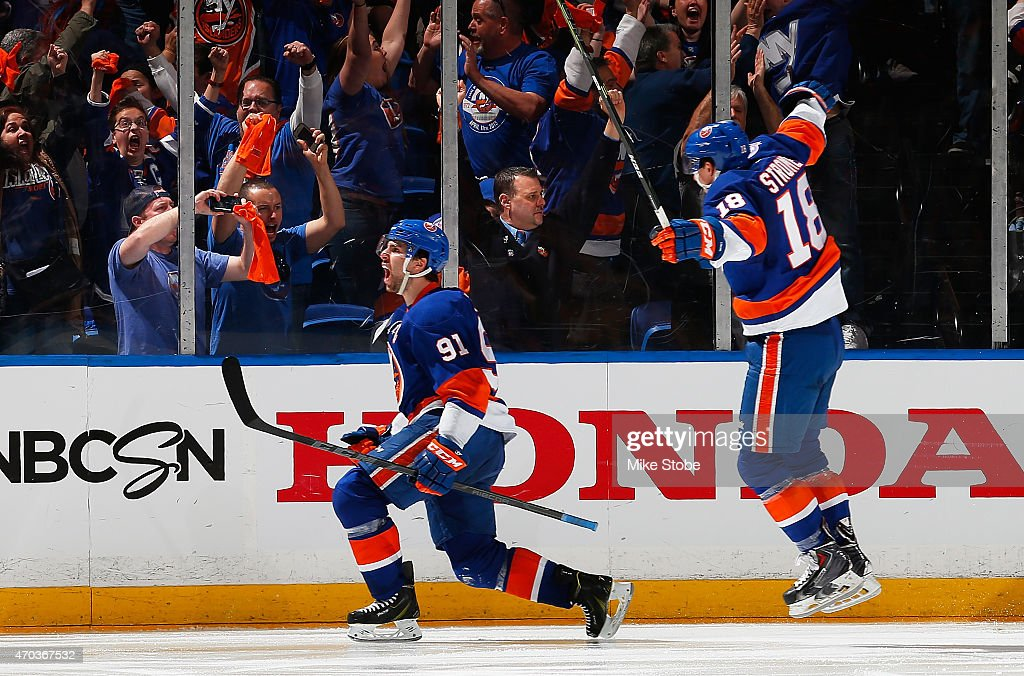John Tavares #91 of the New York Islanders celebrates his game winning goal in overtime with teammate Ryan Strome #18 during the game against the Washington Capitals during Game Three of the Eastern Conference Quarterfinals during the 2015 NHL Stanley Cup Playoffs at Nassau Veterans Memorial Coliseum on April 19, 2015 in Uniondale, New York. The Islanders defeated the Capitals 2-1 in overtime.