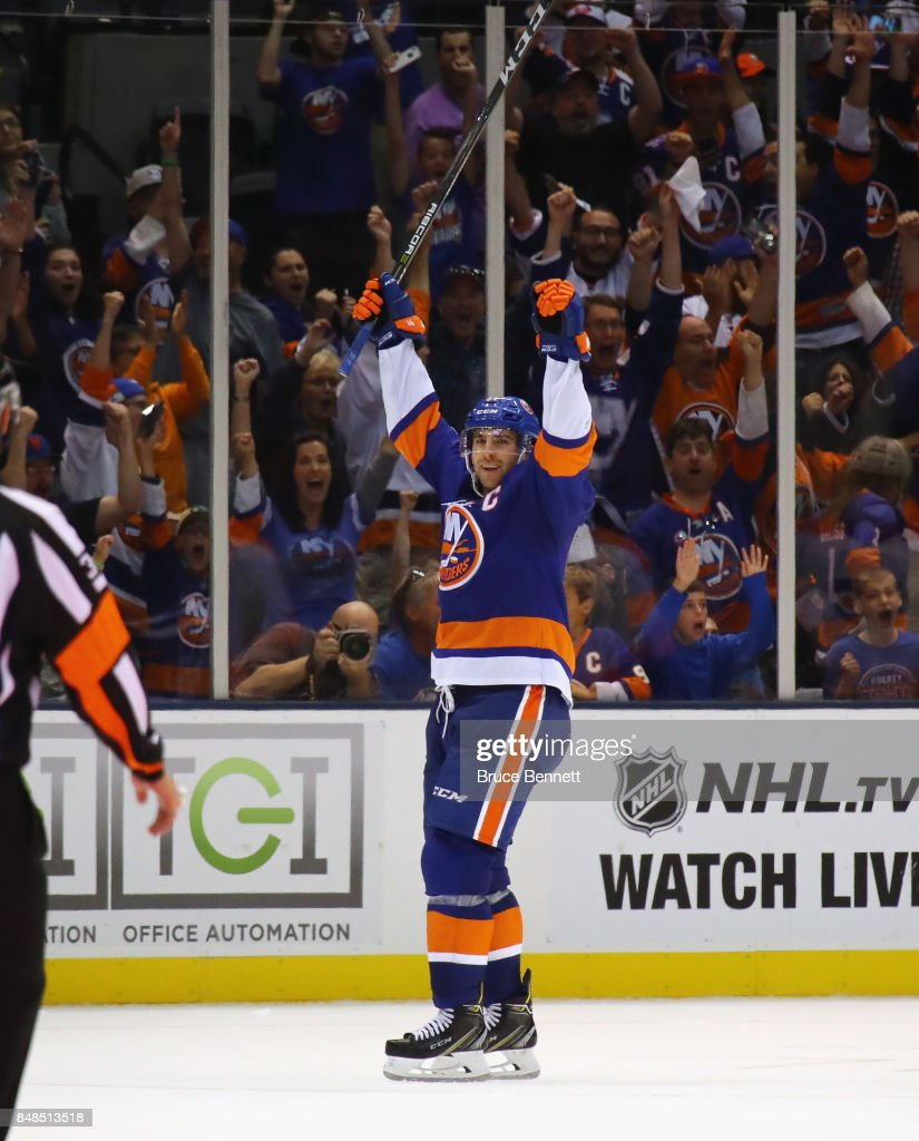 John Tavares #91 of the New York Islanders celebrates his game winning goal at 34 seconds of overtime against the Philadelphia Flyers during a preseason game at the Nassau Veterans Memorial Coliseum on September 17, 2017 in Uniondale, New York. The Islanders defeated the Flyers 3-2 in overtime.
