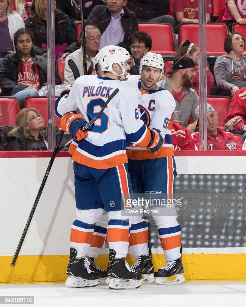 John Tavares of the New York Islanders celebrates his overtime game winning goal with teammate Ryan Pulock during an NHL game against the Detroit Red...