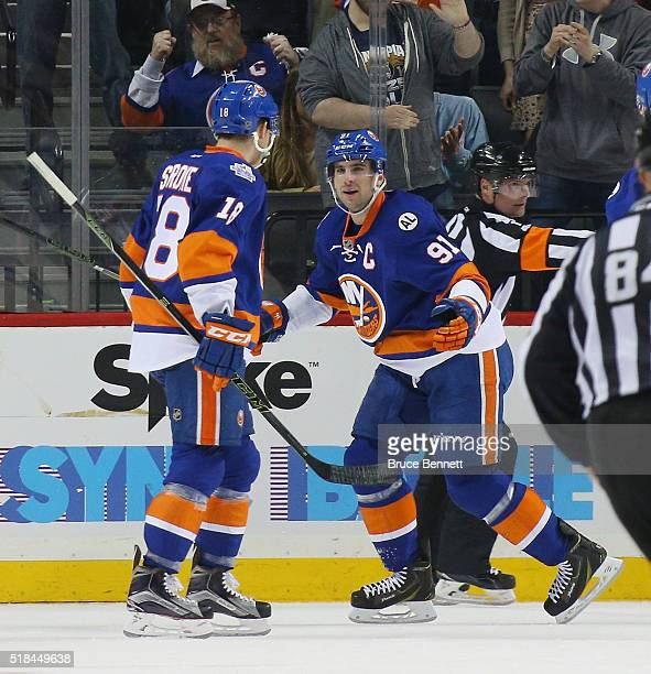 John Tavares of the New York Islanders celebrates his second goal of the first period at 1832 against the Columbus Blue Jackets and is joined by Ryan...