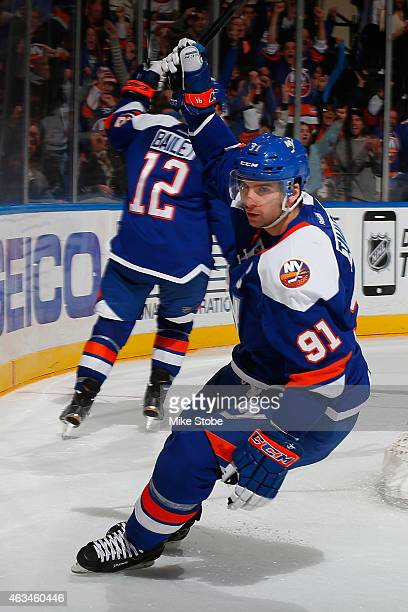John Tavares of the New York Islanders celebrates his third period goal against the Columbus Blue Jackets at Nassau Veterans Memorial Coliseum on...