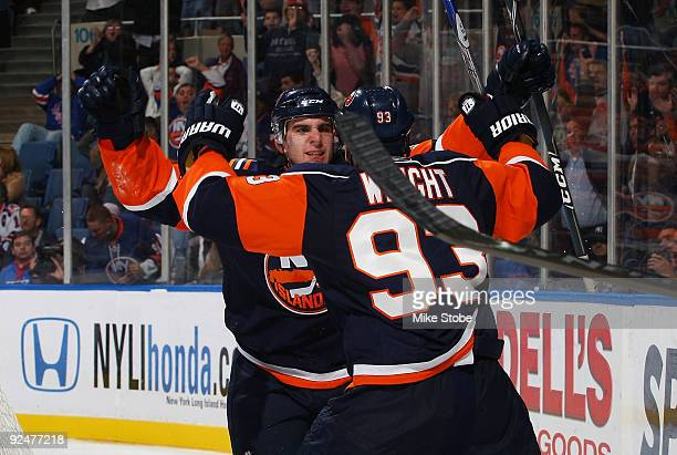 John Tavares of the New York Islanders celebrates his thirdperiod goal with teammate Doug Weight in a game against the New York Rangers on October 28...