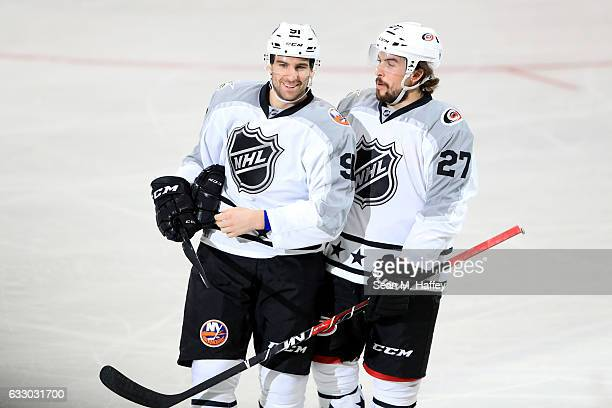 John Tavares of the New York Islanders celebrates with Justin Faulk of the Carolina Hurricanes after scoring a goal during the 2017 Honda NHL AllStar...