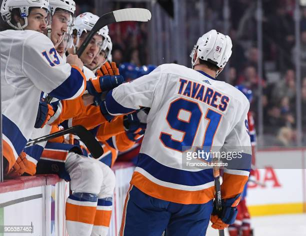 John Tavares of the New York Islanders celebrates with the bench after scoring a goal against the Montreal Canadiens in the NHL game at the Bell...