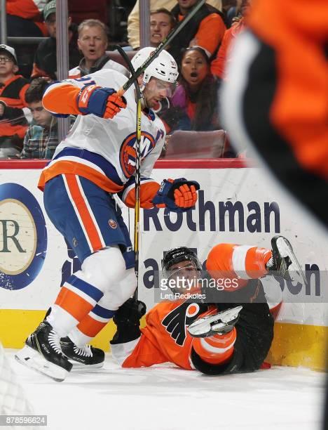 John Tavares of the New York Islanders checks Danick Martel of the Philadelphia Flyers to the ice on November 24 2017 at the Wells Fargo Center in...