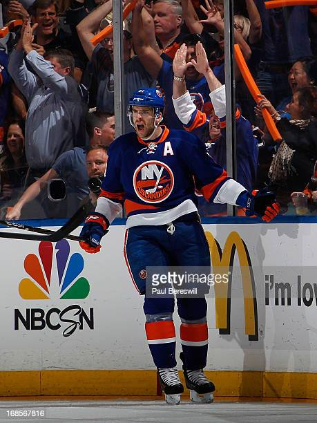 John Tavares of the New York Islanders cheers his goal along with fans in the first period against the Pittsburgh Penguins in Game Six of the Eastern...